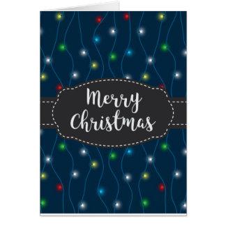 Blåttjulen stränger ljusgod julkortet hälsningskort