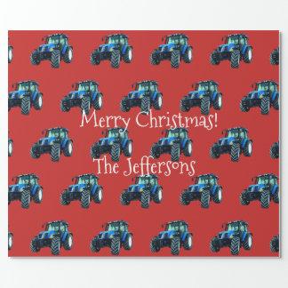 Blåttlantgårdtraktorer på röd jul presentpapper