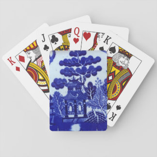 Blåttpil som leker kort casinokort