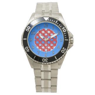 Blåttvitstjärnor på rött armbandsur