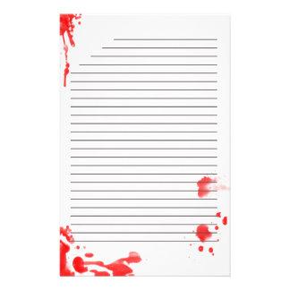 Blod befläckt stationärt brevpapper