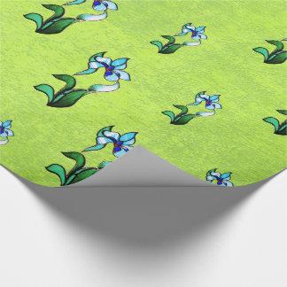Blommar grönt neon för blått på abstraktgrönt presentpapper