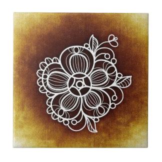 Blommig brunt kakelplatta