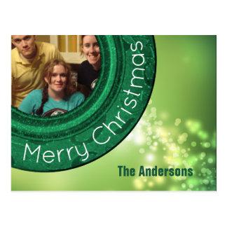 Bokeh för grönt för god julfotokort Sparkles Vykort