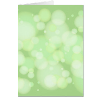 Bokeh grönt cirklar hälsningskort