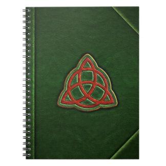Boken av skuggar täcker anteckningsboken anteckningsbok med spiral