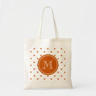 Brända orange glitterhjärtor med monogramen budget tygkasse