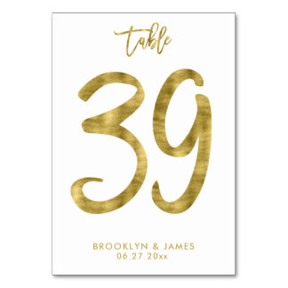 Bröllopbordsnumret som guld omkullkastar, bordsnummer