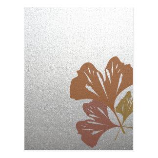 Brons ginkgoen som löv på silver verkställer vykort