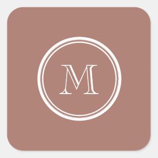 Brons kicken avslutar den kulöra monogramen fyrkantigt klistermärke