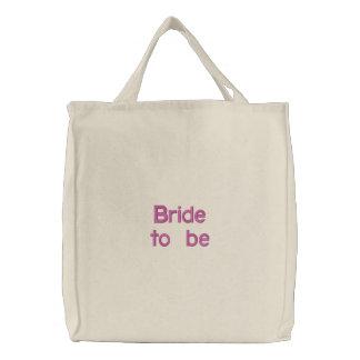 Bruden som är den broderade totot, hänger lös broderad tygkasse