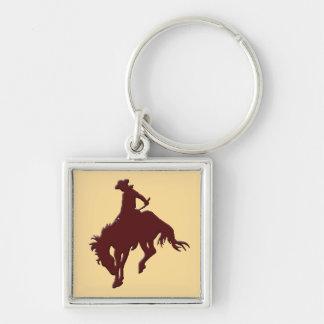 Brun guld- Cowboy som sparkar bakut hästen Fyrkantig Silverfärgad Nyckelring