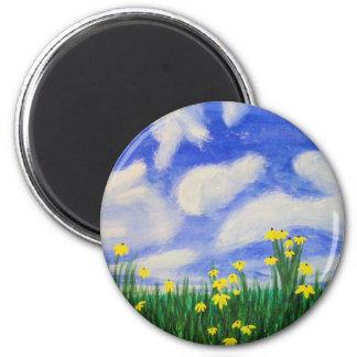 Buktcoven blommar i ett ljust fält magnet
