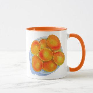 Bunke av mango mugg