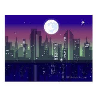 Byggnader som tändas upp på natten vykort