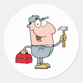 Byggnadsarbetaren med bultar, och verktyg boxas runt klistermärke