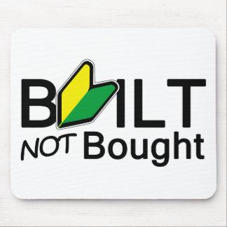 Byggt, inte köpt musmatta