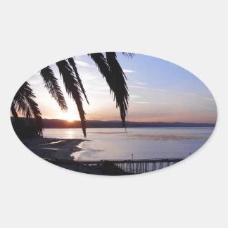 Capitola soluppgång ovalt klistermärke