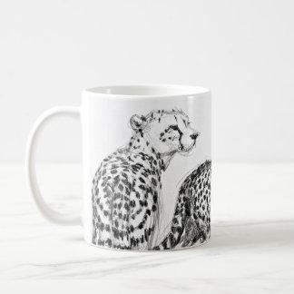 Cheetahs på den automatiskt linjeskiftsvarten & kaffemugg