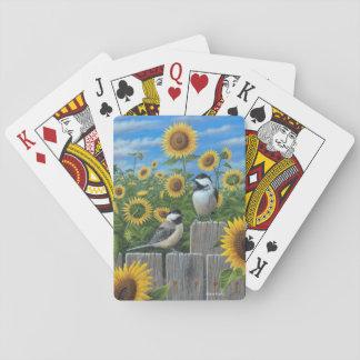 Chickadees och solrosor som leker kort casinokort