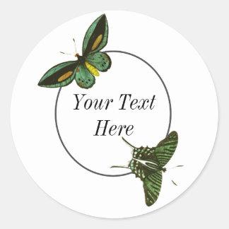 Cirkla och göra grön fjärilar runt klistermärke