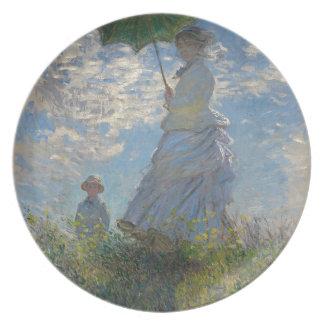Claude Monet - kvinna med ett ett slags Tallrik