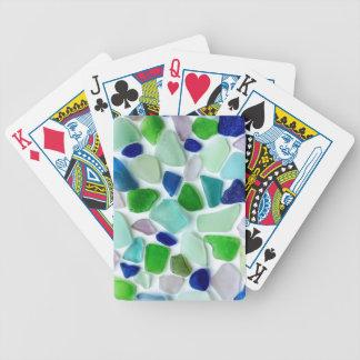 Coolan färgar havsexponeringsglas som leker kort spelkort