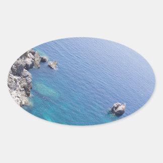 Corfu bevattnar ovalt klistermärke