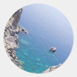 Corfu bevattnar runt klistermärke