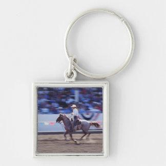 Cowboy på rodeoen fyrkantig silverfärgad nyckelring