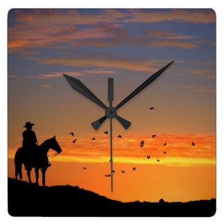 Cowboyen tar tid på upp fyrkantig klocka