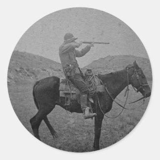 Cowboyjakt på skjuten hästrygg en runt klistermärke