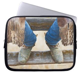 Cowboykängor på staket laptop fodral