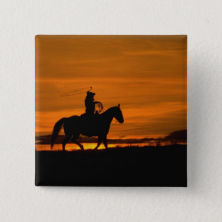 Cowboyridning i solnedgången med lariatrepet standard kanpp fyrkantig 5.1 cm