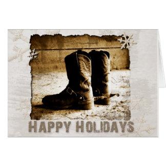 Cowboys lantlig helgdag för hälsning för kängajul hälsningskort