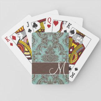 Damastast mönster för vintage med monogramen spel kort