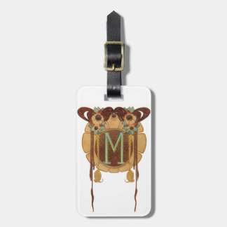 Dekorativ M bagagemärkre för art nouveau Bagagebricka