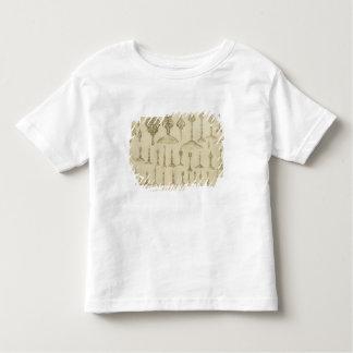 Dekorativa knoppar som formas som kupoler och t shirts