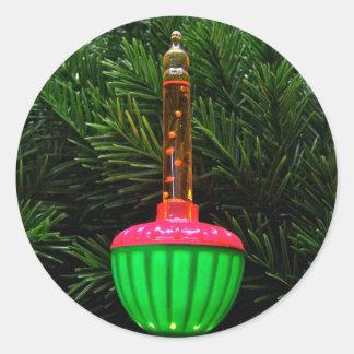 Dekorativt bubbla ljusa helgdagklistermärkear runt klistermärke