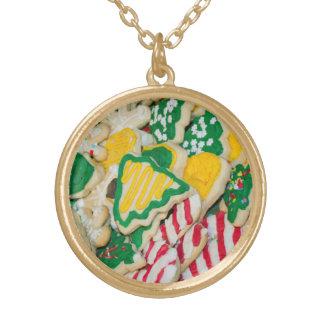 Dekorerade frostade hemlagade julsockerkakor guldpläterat halsband