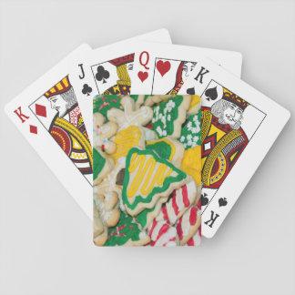 Dekorerade frostade hemlagade julsockerkakor spel kort