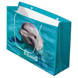 Delfin i blåttvattenfoto