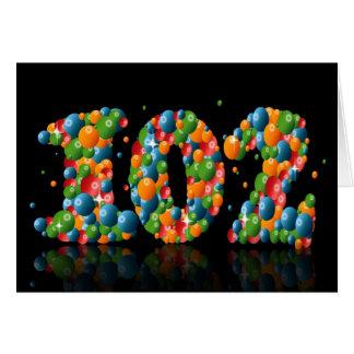 den 102. födelsedagen med numrerar bildat från hälsningskort