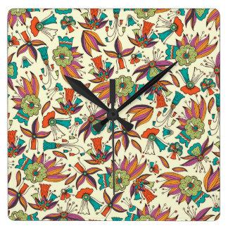 den abstrakt blommönstret kvadrerar väggen tar tid fyrkantig klocka