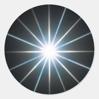 Den abstrakt kristallen reflekterar stjärnan runt klistermärke