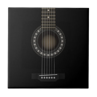 Den akustiska gitarren belägger med tegel kakelplatta