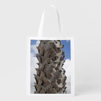 Den återvinningsbara lurviga palmträdet hänger lös återanvändbar påse
