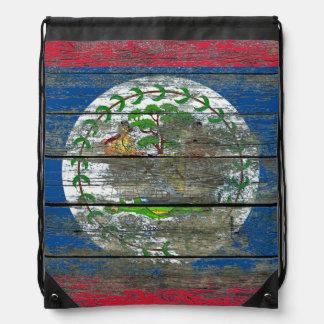 Den Belize flagga på grovt trä stiger ombord Gympapåse
