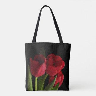 Den blom- röda trädgårds- tulpanblommatotot hänger tygkasse
