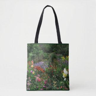 Den blom- sommarblomsterträdgårdtotot hänger lös tygkasse